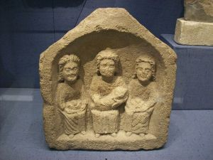 Three goddesses, small Roman relief, Corinium Museum. Photo by Tony Grist (Public domain)