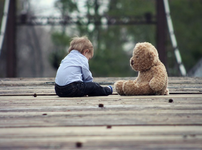A boy and a bear. Source: Pixabay [Public Domain].